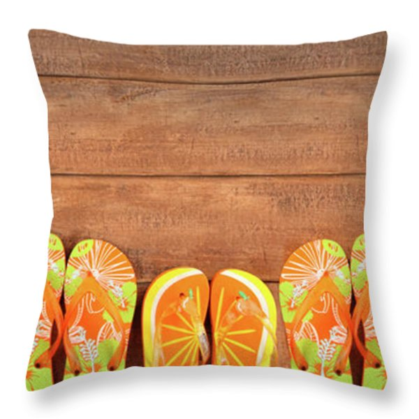 Brightly Colored Flip-flops On Wood  Throw Pillow by Sandra Cunningham