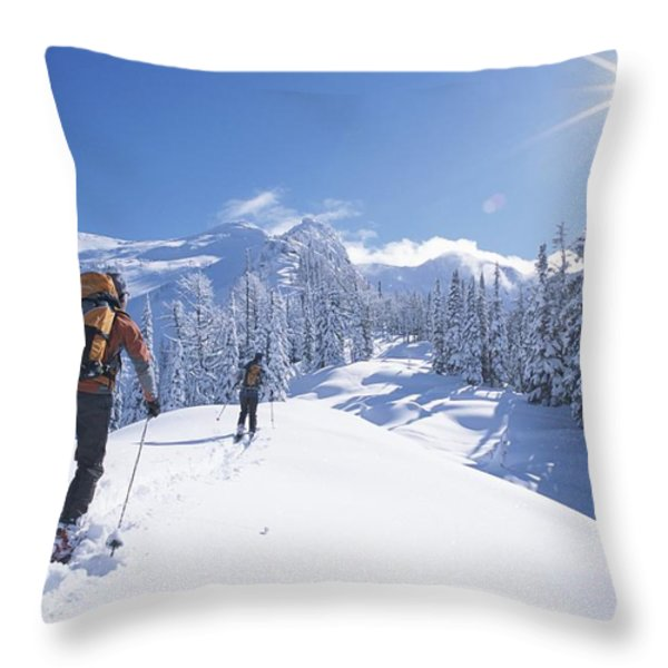 Cross-country Skiers In The Selkirk Throw Pillow by Jimmy Chin