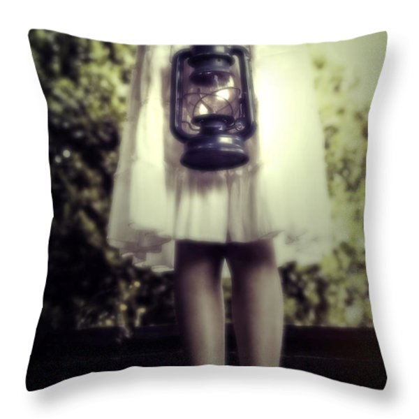 girl with oil lamp Throw Pillow by Joana Kruse
