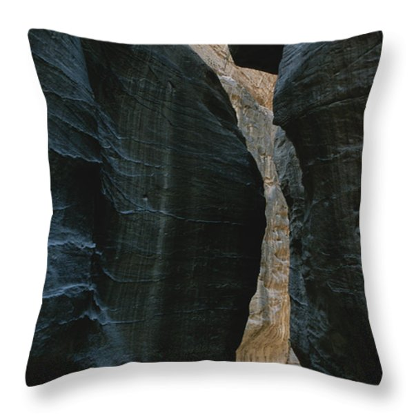 Hikers In The Siq Canyon Leading Throw Pillow by Gordon Wiltsie