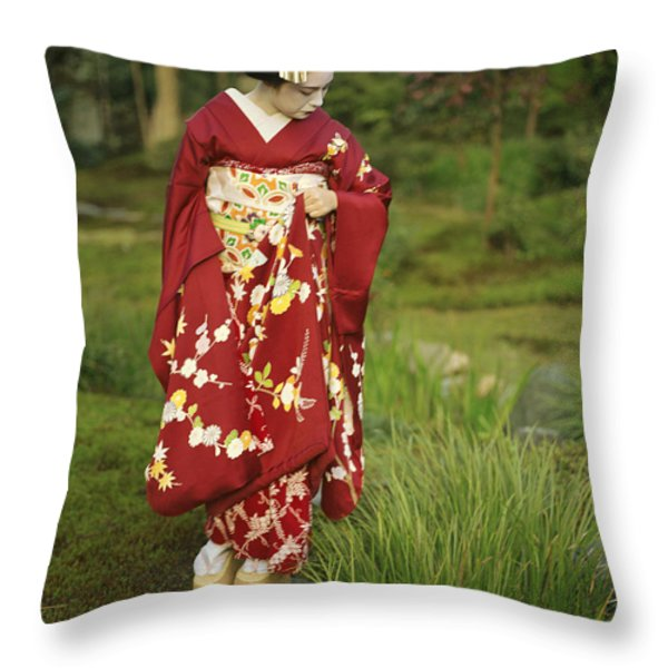 Kimono-clad Geisha In A Park Throw Pillow by Justin Guariglia