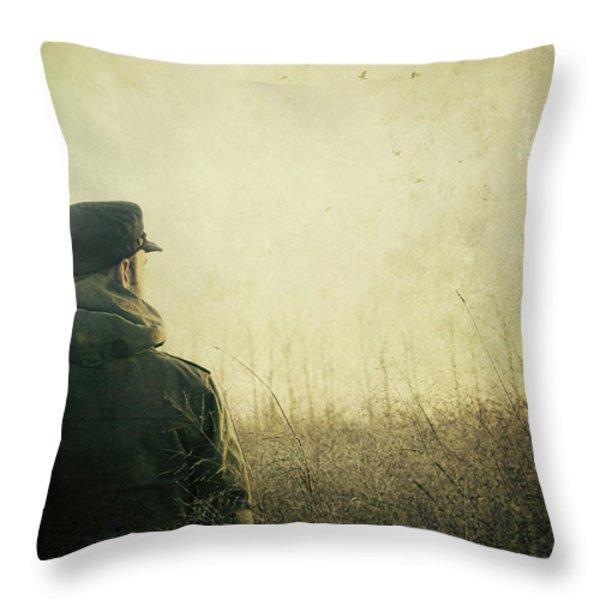 Man Alone In Autumn Field Throw Pillow by Sandra Cunningham