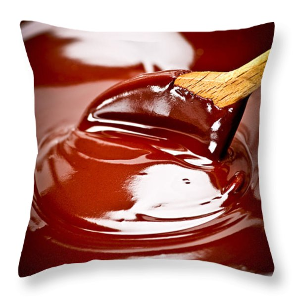 Melted chocolate and spoon Throw Pillow by Elena Elisseeva
