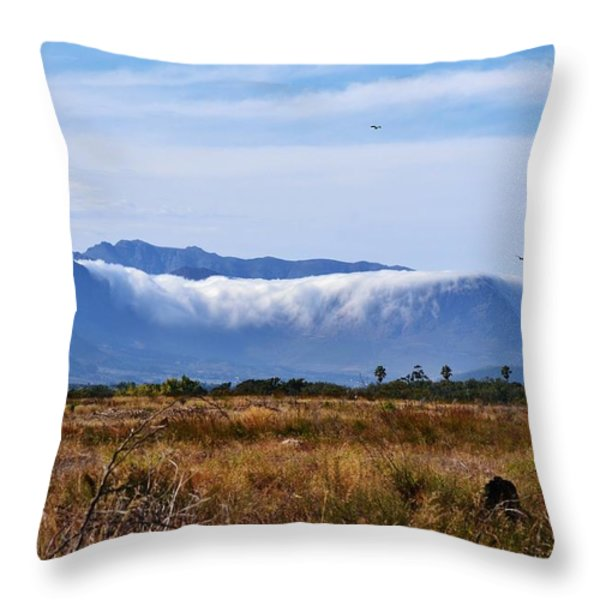 Mountains in clouds Throw Pillow by Werner Lehmann