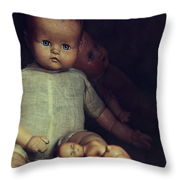 Old Dolls Sitting On Wooden Table Throw Pillow by Sandra Cunningham