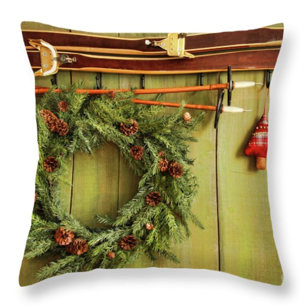 Old Pair Of Skis Hanging With Wreath Throw Pillow by Sandra Cunningham
