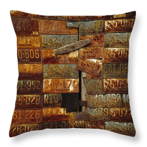 Side Of A Building Adorned With Old Throw Pillow by Raymond Gehman