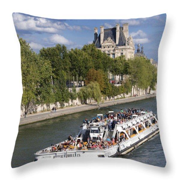 Sightseeing boat on river Seine to Louvre museum. Paris Throw Pillow by BERNARD JAUBERT