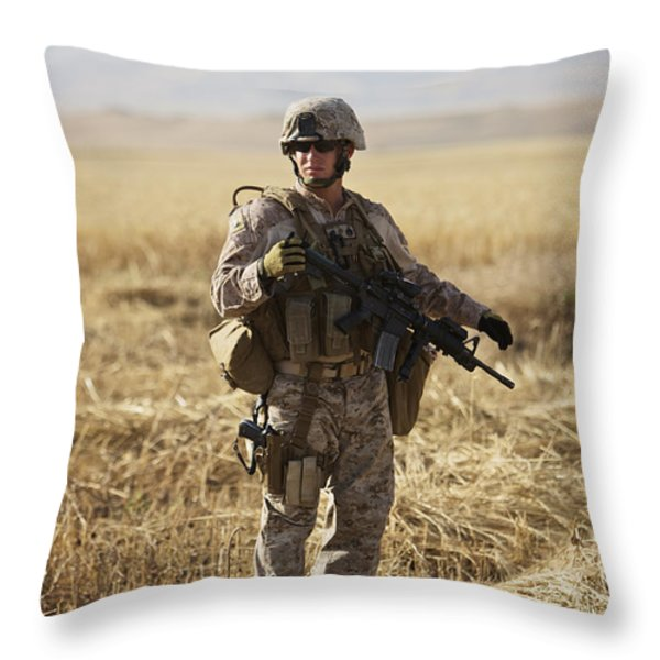 U.s. Marine Patrols A Wadi Near Kunduz Throw Pillow by Terry Moore