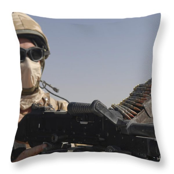 A British Army Soldier Mans A Machine Throw Pillow by Andrew Chittock