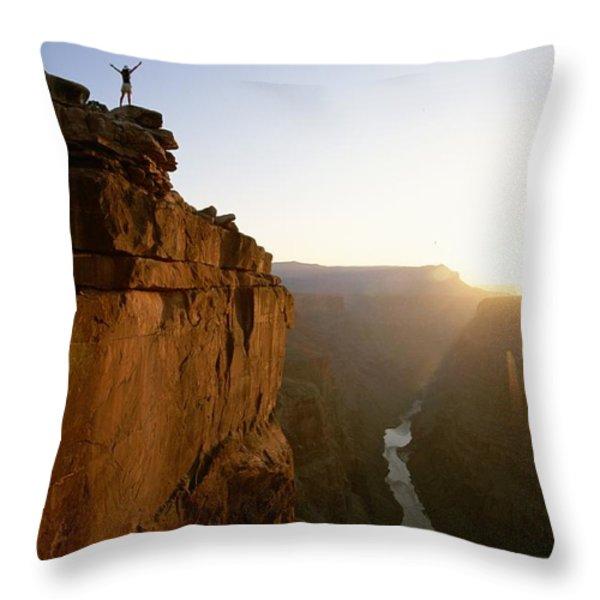 A Hiker Surveys The Grand Canyon Throw Pillow by John Burcham