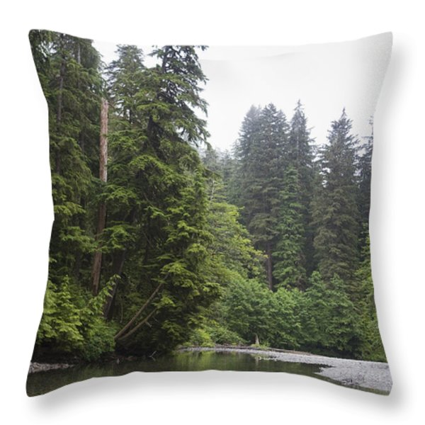 A Man Wades In A River In A Temperate Throw Pillow by Taylor S. Kennedy