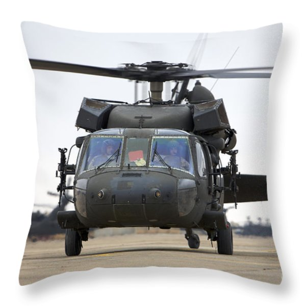 A Uh-60 Black Hawk Taxis Throw Pillow by Terry Moore