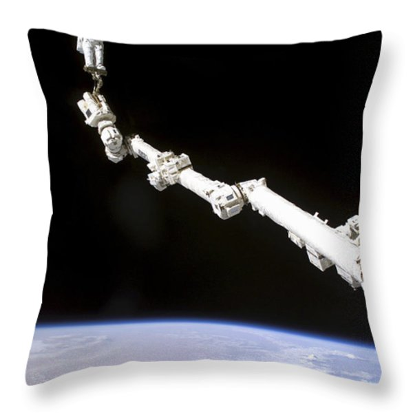 Astronaut Anchored To A Foot Restraint Throw Pillow by Stocktrek Images