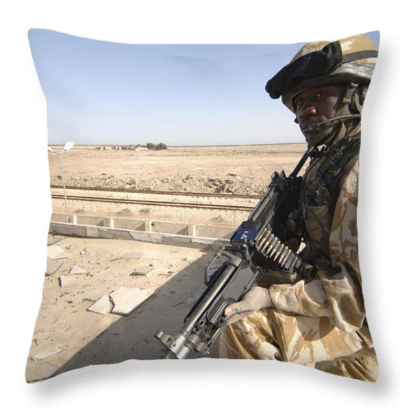 A British Army Soldier Provides Throw Pillow by Andrew Chittock