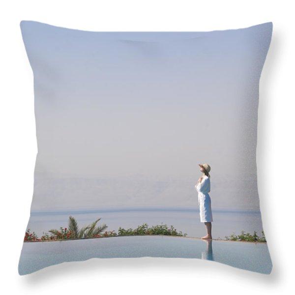 A Woman Enjoys The Warm Sun On The Edge Throw Pillow by Taylor S. Kennedy