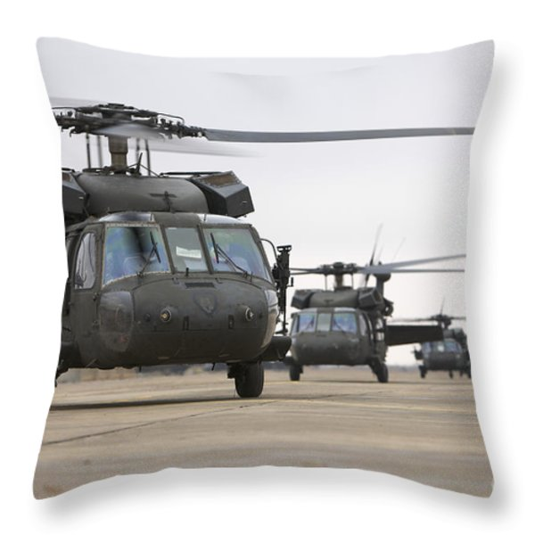 Uh-60 Black Hawks Taxis Throw Pillow by Terry Moore