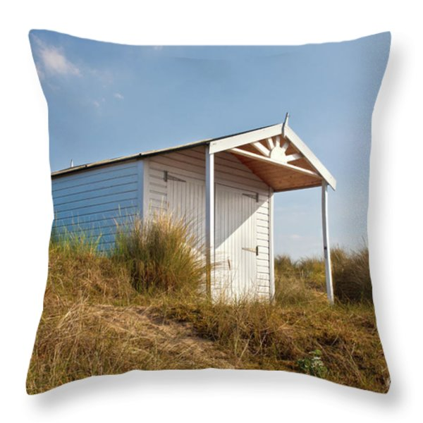 A Beach hut in the Marram Grass at Old Hunstanton North Norfolk Throw Pillow by John Edwards