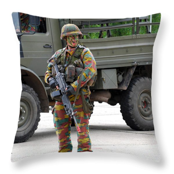 A Belgian Infantry Soldier Handling Throw Pillow by Luc De Jaeger