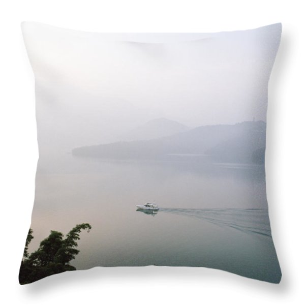 A Boat Cuts Into The Still Waters Throw Pillow by Justin Guariglia