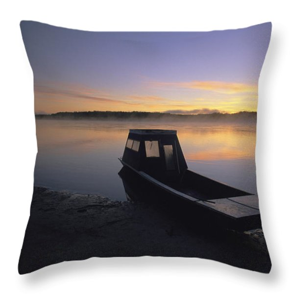 A Boat Sits On The Calm Yukon River Throw Pillow by Michael Melford