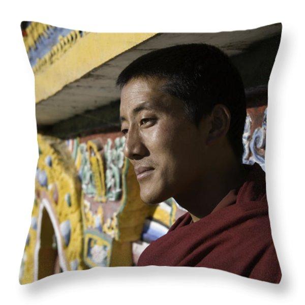 A Buddhist Monk Near The Edge Throw Pillow by David Evans