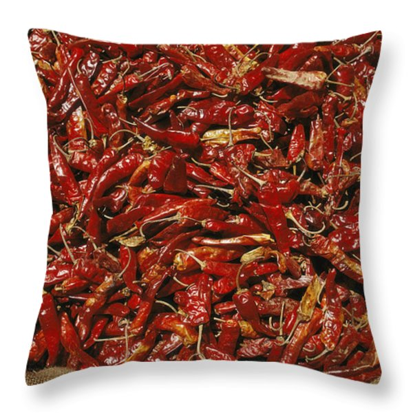 A Burlap Bag Full Of Red Hot Peppers Throw Pillow by James P. Blair