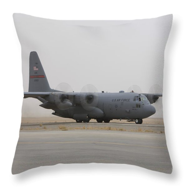 A C-130 Hercules Aircraft Taxis Throw Pillow by Terry Moore