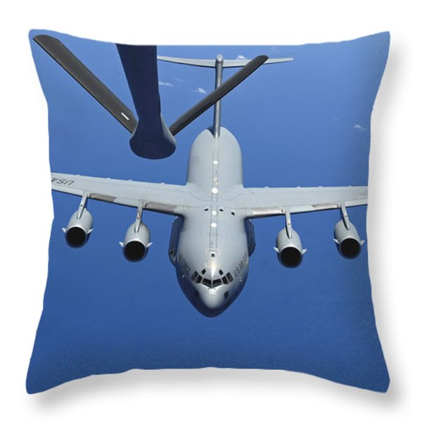 A C-17 Globemaster Iii Approaches Throw Pillow by Stocktrek Images