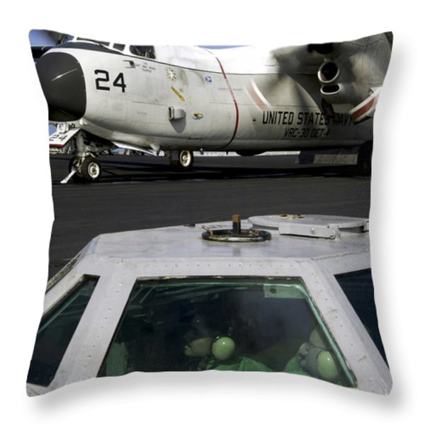 A C-2a Greyhound Prepares For Launch Throw Pillow by Stocktrek Images