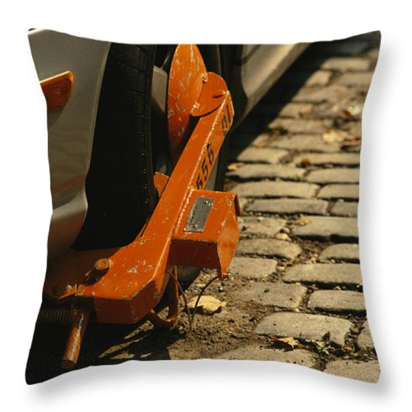 A Car With A Booted Tire Throw Pillow by Richard Nowitz