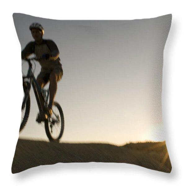 A Caucasian Man Mountain Bikes Throw Pillow by Bobby Model