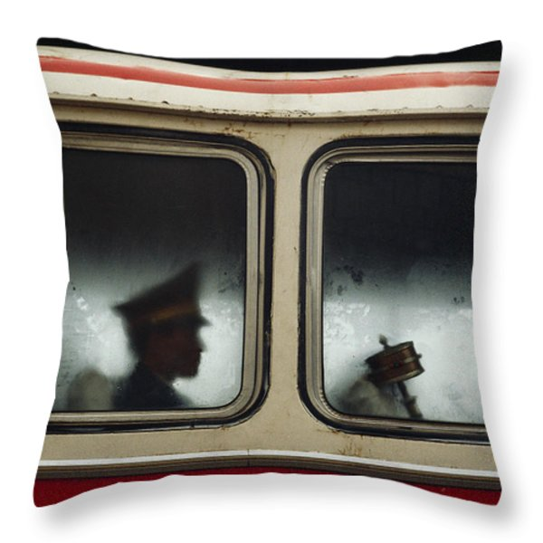 A Chinese Pla Soldier Sits On A Bus Throw Pillow by Justin Guariglia