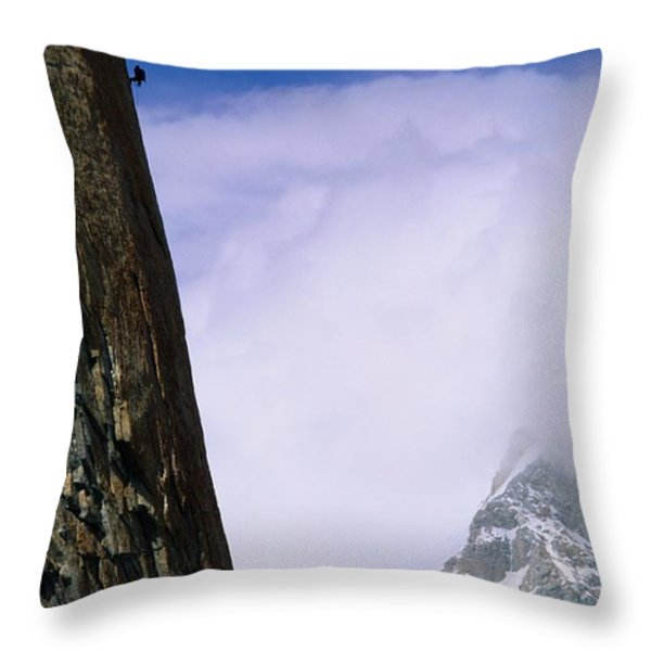 A Climber Rappels Down The Sheer Throw Pillow by Bill Hatcher
