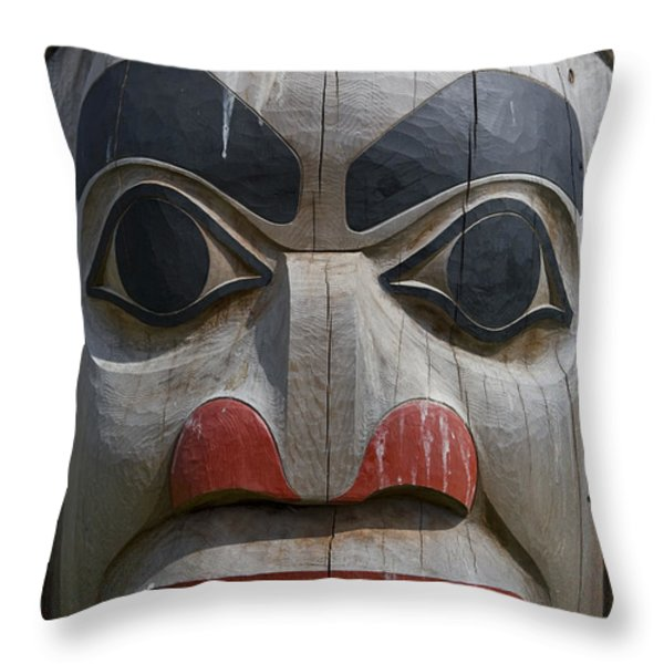 A Close View Of The Carvings Of A Totem Throw Pillow by Taylor S. Kennedy