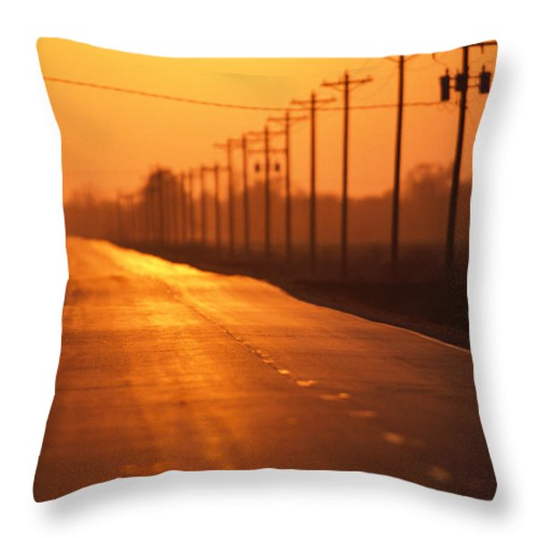 A Country Highway Fades Into The Sunset Throw Pillow by Joel Sartore
