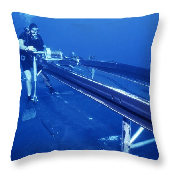 A Crewman Cranks Out The Dry Deck Throw Pillow by Michael Wood