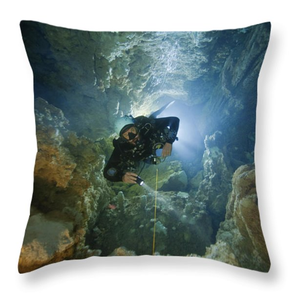 A Diver Ascends A Deep Shaft In Dans Throw Pillow by Wes C. Skiles