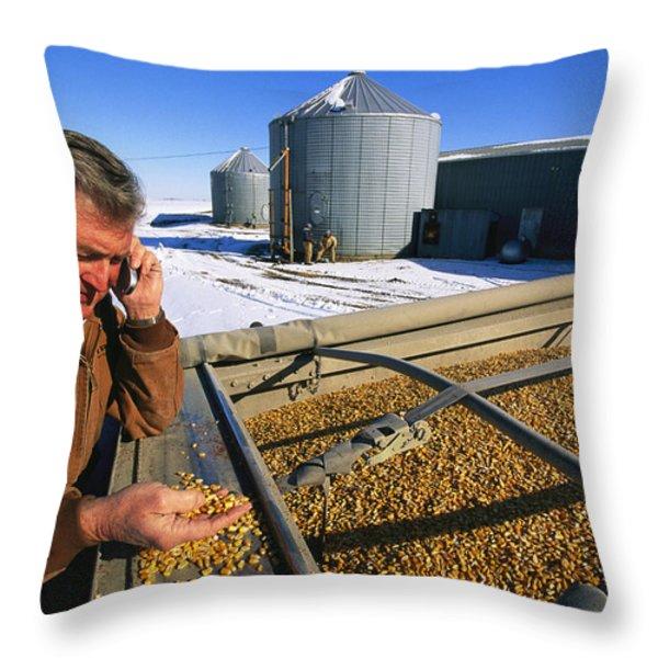 A Farmer Runs His Corn Through His Hand Throw Pillow by Joel Sartore