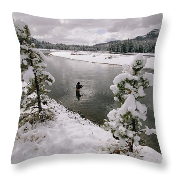A Fisherman Tries His Luck Throw Pillow by Annie Griffiths