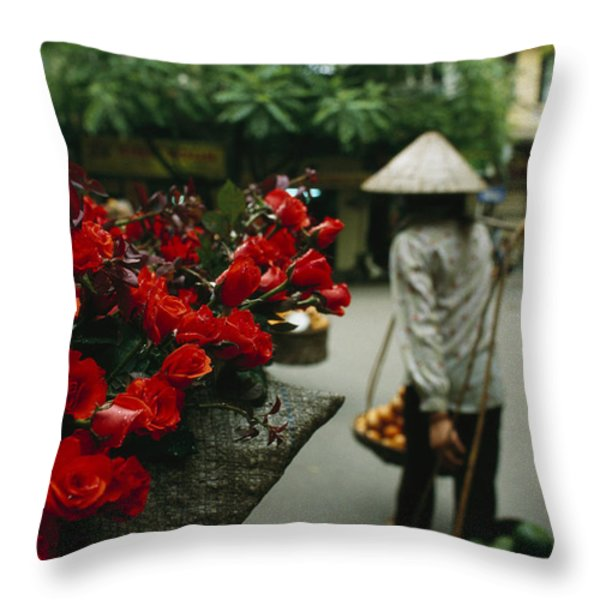 A Fruit Vendor In A Conical Hat Passes Throw Pillow by Justin Guariglia