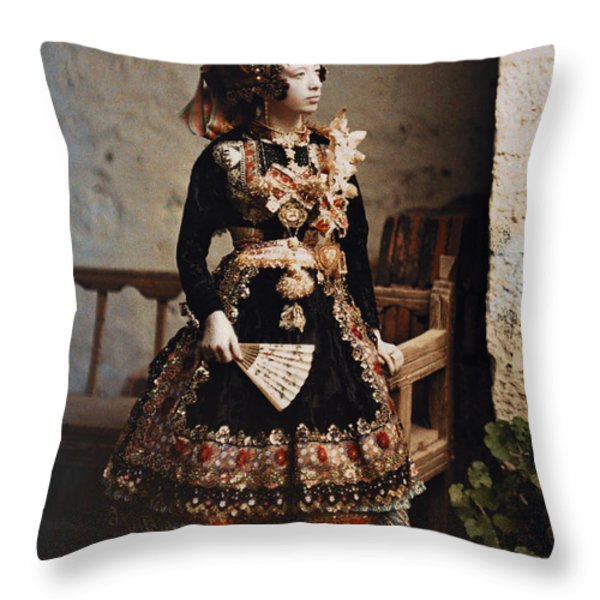 A Girl Poses In Her Traditional Costume Throw Pillow by Gervais Courtellemont