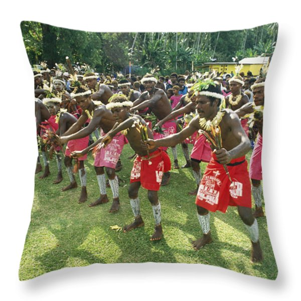 A Group Of New Guinean Men Performing Throw Pillow by Klaus Nigge