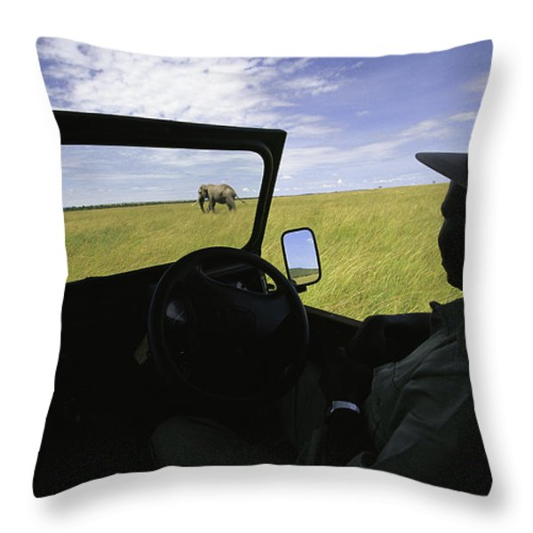 A Guide In A Jeep Observing An African Throw Pillow by Michael Melford
