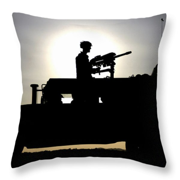 A Gunner Mans An Mk-19 40mm Machine Gun Throw Pillow by Stocktrek Images