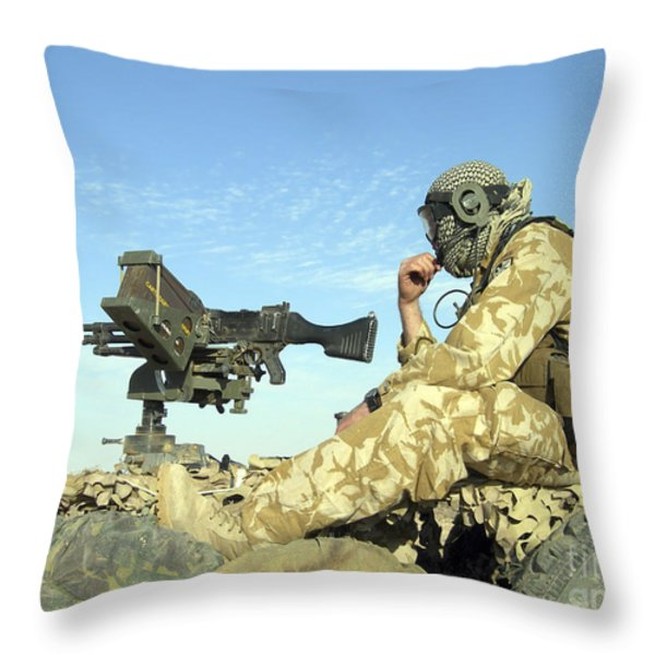 A Gunner Sits Atop A British Army Wmik Throw Pillow by Andrew Chittock