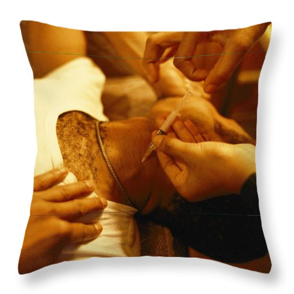 A Heroin Addict Receives An Injection Throw Pillow by Steve Raymer