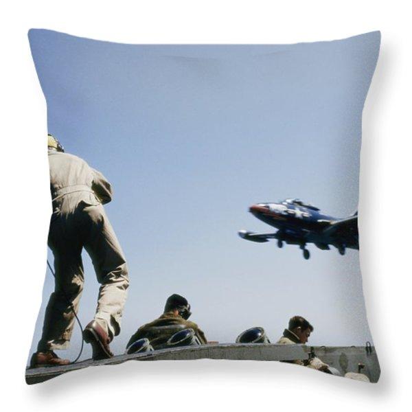 A Jet Lands Onboard An Aircraft Carrier Throw Pillow by J. Baylor Roberts