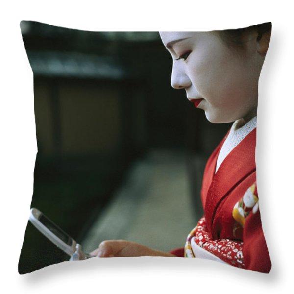 A Kimono-clad Geisha Dials Her Cell Throw Pillow by Justin Guariglia