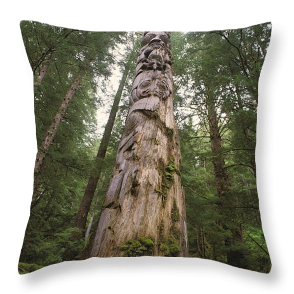 A Large Totem Pole Stands Amid Tall Throw Pillow by Bill Curtsinger